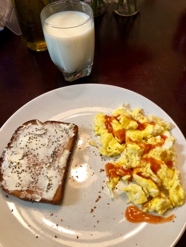Scrambled eggs, toast with cream cheese and chia seeds